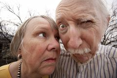 Crazy Couple. Closeup portrait of crazy elderly couple outdoors Stock Photography