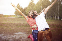 Crazy couple during rain Stock Photos