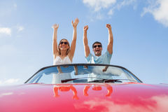 Crazy couple standing in red cabriolet Royalty Free Stock Images