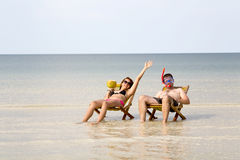 Crazy couple sunbathing, fantastic crystal water, koh rong island, cambodia Stock Photography