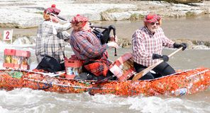 Crazy Craft River Race, Port Hope, March 31/2012. Participants paddle a home made raft through the Ganaraska River rapids on March 31, 2012 in Port Hope, Ontario royalty free stock image