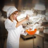 Crazy cream. Chef prepares a cream splashing from bowl Royalty Free Stock Image