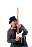 Crazy Cross Eyed Guitarist Staring at Guitar Royalty Free Stock Photo