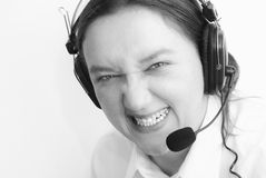Crazy customer support. Funny crazy angry customer support lady with headset. Black and white image royalty free stock image