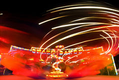 Crazy Dance. Blur neon lights in amusement park, long exposure Royalty Free Stock Photo