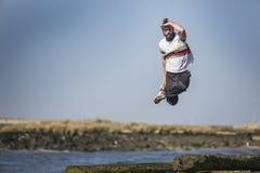 Crazy Dancer boy jumping high royalty free stock photo