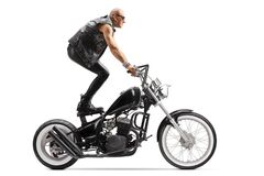 Free Crazy Daredevil Biker Riding A Chopper And Standing On The Seat Stock Photography - 180986412
