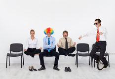 Crazy day at the office. People managing a hectic business day Royalty Free Stock Photos