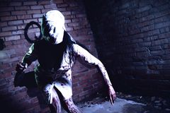 Crazy dead Silent Hill nurse with knife in hand Stock Images