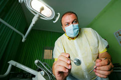 Crazy dentist. In mask during work Royalty Free Stock Photos