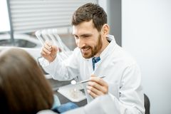 Crazy dentist during the procedure in the dental office stock photos