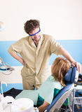 Crazy dentist treats teeth of the unfortunate Royalty Free Stock Photography