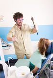 Crazy dentist treats teeth of the unfortunate Royalty Free Stock Photos