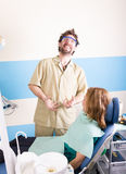 Crazy dentist treats teeth of the unfortunate Stock Photo