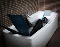 Crazy diver in a jacuzzi bathtub Stock Photos