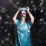 Crazy doctor clown laughing in rain Stock Images