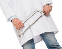 Crazy doctor is holding a big saw in his hands Royalty Free Stock Image