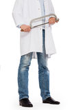 Crazy doctor is holding a big saw in his hands Stock Photography