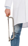Crazy doctor is holding a big saw in his hands Stock Images