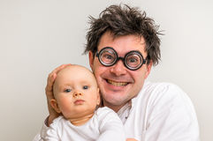 Crazy doctor with newborn baby in his hands Stock Photography