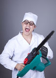 Crazy doctor with portable saw. Stock Photos