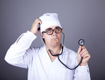 Crazy doctor with a stethoscope. Royalty Free Stock Photos