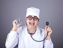 Crazy doctor with a stethoscope and enema. Royalty Free Stock Photo