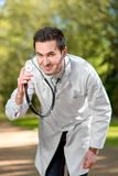 Crazy doctor with stethoscope Royalty Free Stock Photos