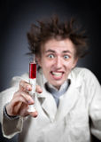 Crazy doctor with syringe Royalty Free Stock Images
