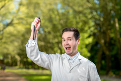 Crazy doctor waving stethoscope Royalty Free Stock Photo