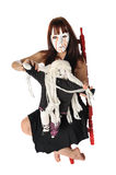 Crazy doll lady. Crazy woman in a mask playing with a doll on a white background Stock Photos
