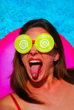 Crazy about Dreamstime. Caucasian white woman going crazy about the Dreamstime fashion with Dreamstime logo tongue piercing and Dreamstime sunglasses Royalty Free Stock Image