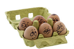 Crazy Eggs. 6 crazy eggs with emotional faces in an eggs box Royalty Free Stock Photography