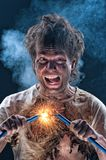 Crazy electrician Stock Image
