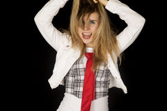 Crazy excited female model with her tongue out pulling hair up Stock Images