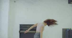Crazy expressive woman playing piano in dance studio stock footage