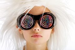 Crazy Eyed Kid. A young girl with a wild white wig and crazy hypnotic eye novelty glasses Royalty Free Stock Photo