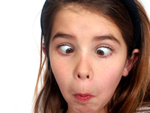 Crazy Eyes. Young girl making a goofy face stock photo