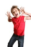 Crazy Face. Child mid jump with a crazy happy face Royalty Free Stock Photo