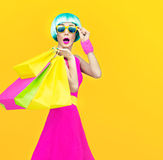 Crazy fashion shopping girl. On yellow background Royalty Free Stock Image
