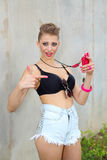 Crazy fashionable girl swearing on the phone. Royalty Free Stock Images
