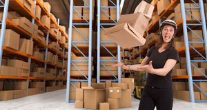 Crazy female courier at warehouse b Royalty Free Stock Photography