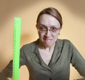 Crazy female teacher. On a yellow background stock photography