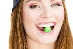 Girl with chewing gum. Crazy fun people concept. Girl with chewing gum. Young woman has cap and long hair stock images