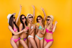 Crazy, funky, summer mood. Cheers to birthday girl! Young five e. Xcited ladies are enjoing at the hen party near the swimpool in trendy swim wear and sunglasses royalty free stock photo