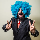 Crazy funny bearded man with blue wig Stock Photo