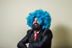 Crazy funny bearded man with blue wig Royalty Free Stock Photos