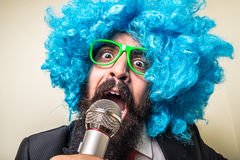 Crazy funny bearded man with blue wig. On white background Royalty Free Stock Photography