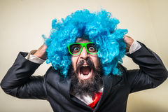 Crazy funny bearded man with blue wig Stock Image