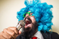 Crazy funny bearded man with blue wig Royalty Free Stock Images